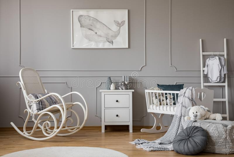 Modern grey baby nursery design in tenement house, copy space and poster on empty wall royalty free stock photos