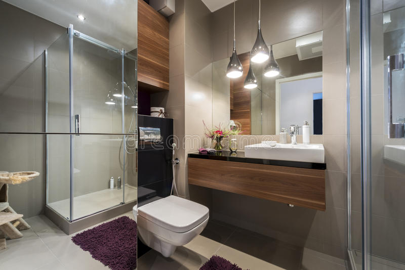 Modern grey and beige bathroom. With shower stock images