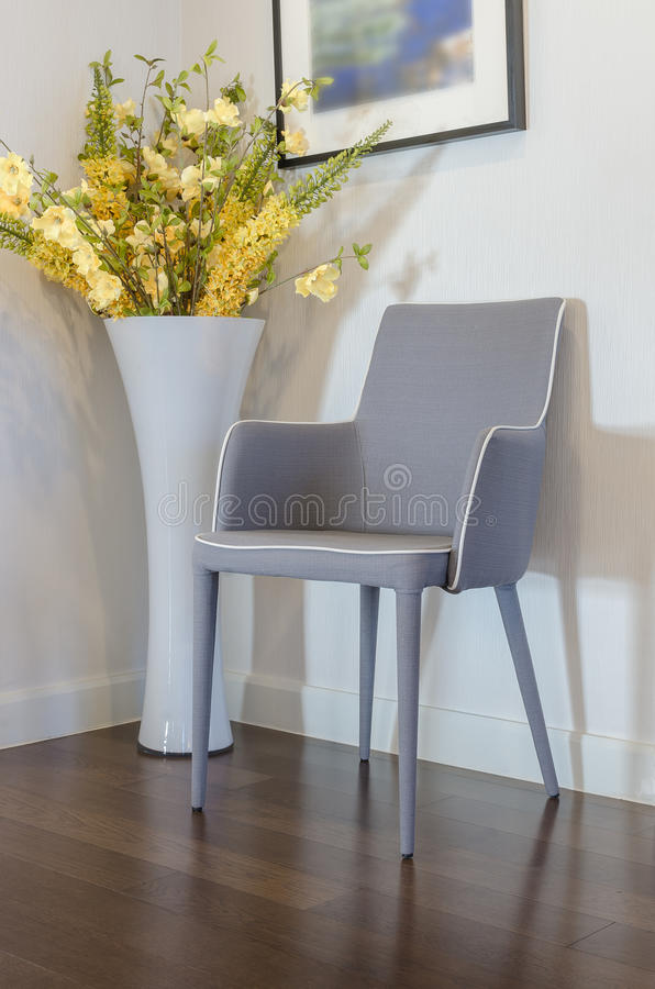 Modern Grey Chair With Yellow Flower In Vase Stock Photo ...