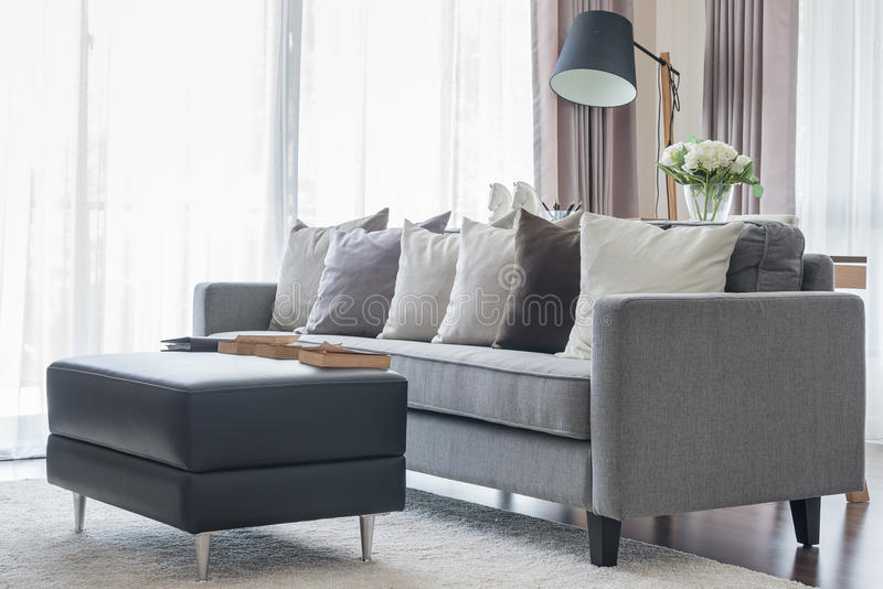 modern grey sofa with pillows and black table in living room stock image image of estate. Black Bedroom Furniture Sets. Home Design Ideas