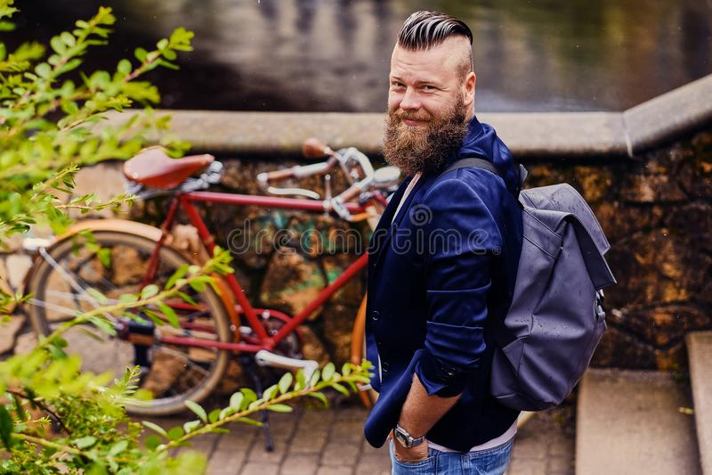 Modern guy with backpack. Back view. royalty free stock photo
