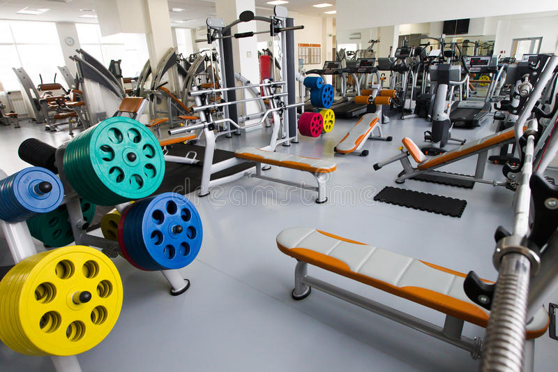 Modern gym. In leisure center fitness machines stock image