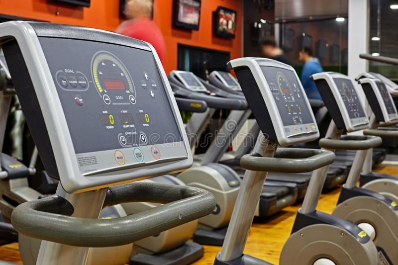 Modern gym interior with equipment. Fitness club with training exercise bikes royalty free stock image