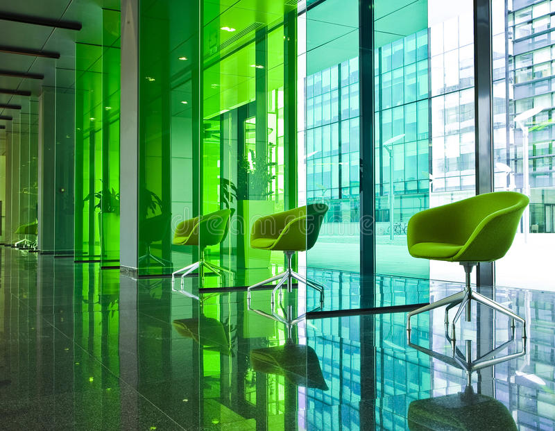 Modern hall with green chairs stock photos