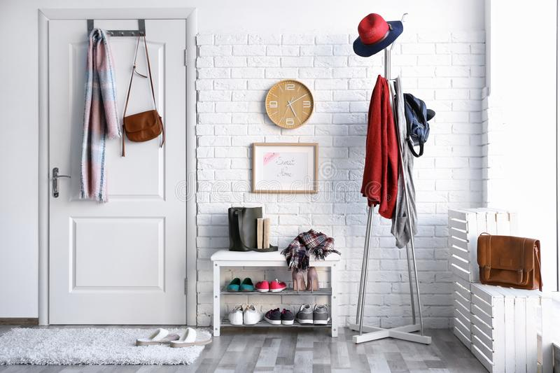 Modern hall interior with clothes stock photography