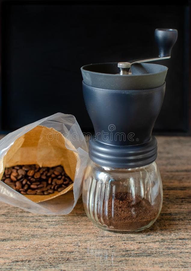 Modern hand coffee grinder and coffee beans royalty free stock photos