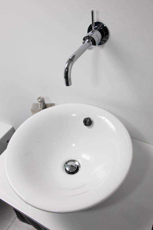 Modern handbasin and tap stock photography
