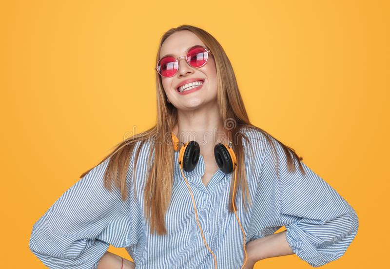 Modern happy hipster woman with headphones stock image