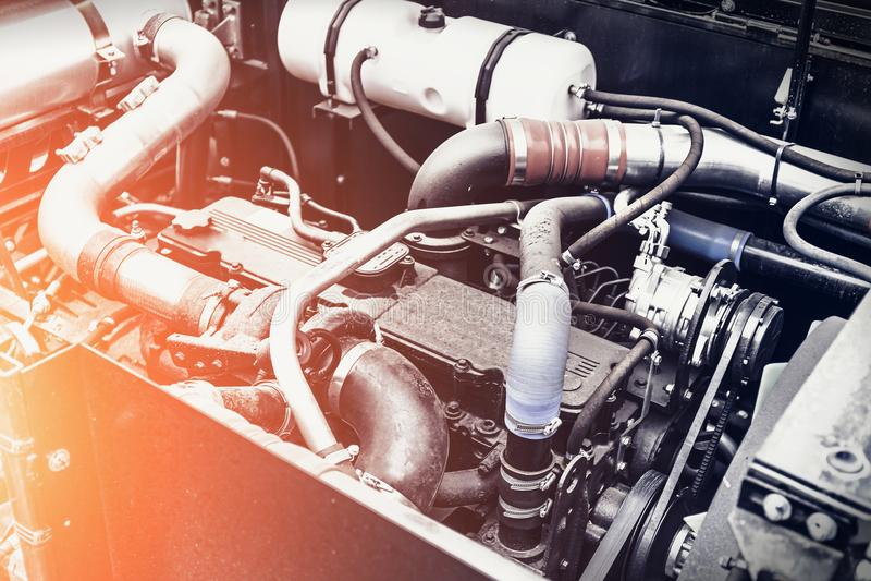 Modern harvester or car engine or motor, new technology concept. Sun light effect, toned stock images