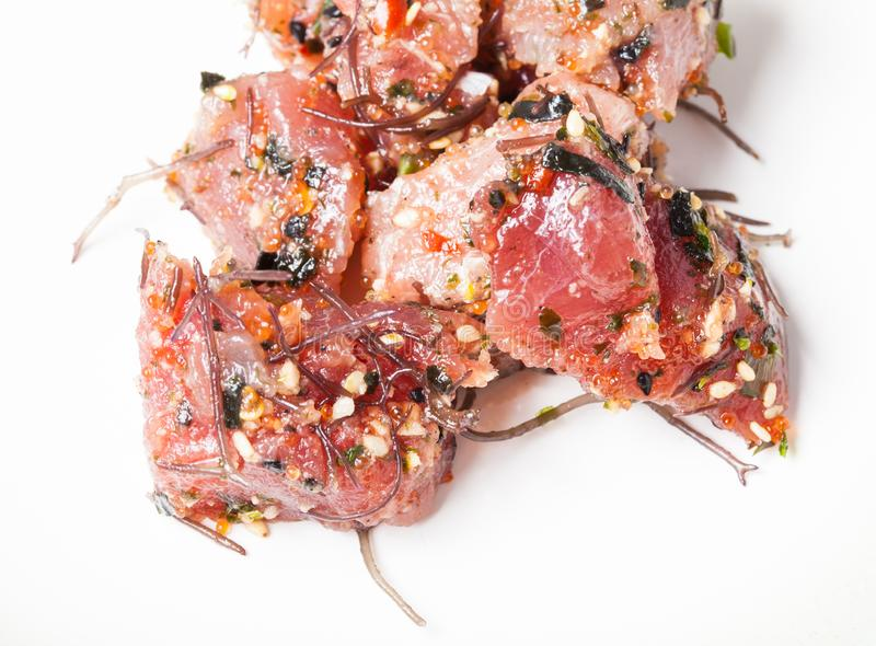 Modern Hawaiian Poke Raw Fish Prepared with Onions and Seaweed stock photos
