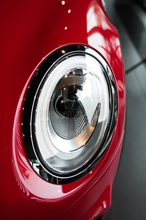 Modern headlight of sport red car stock images
