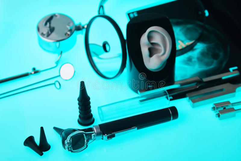 Modern hearing aids on ENT tools background, soft focus. ENT accessory. stock photos