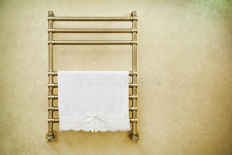 Modern heated towel rail royalty free stock photography