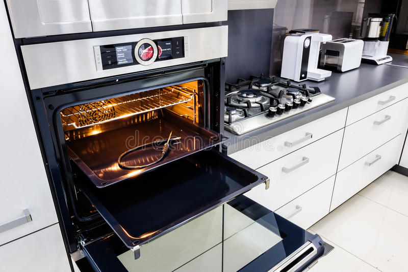 open oven in kitchen. download modern hi-tek kitchen, oven with open door stock photo - image: in kitchen n