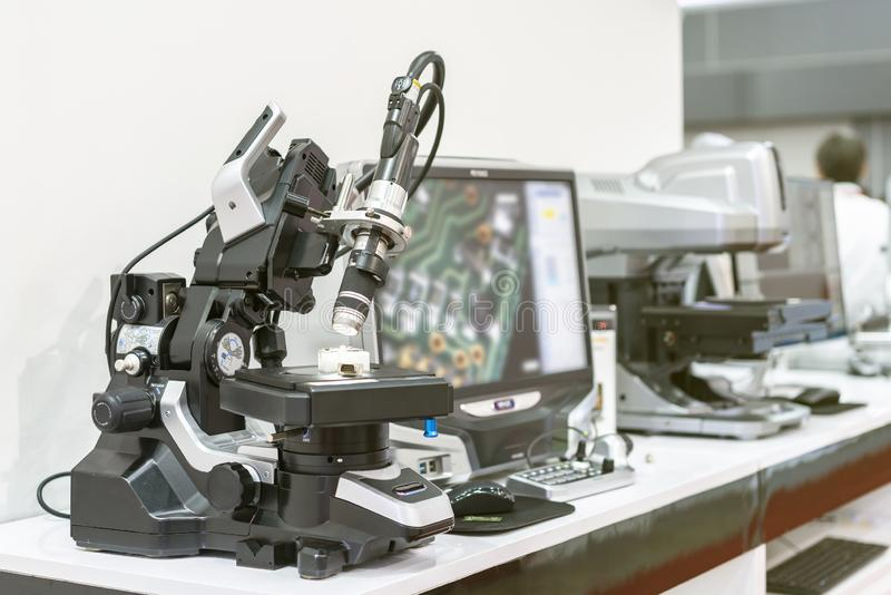 Modern and high accuracy microscope for product inspection of quality control in industrial electronic etc or science laboratory stock photos