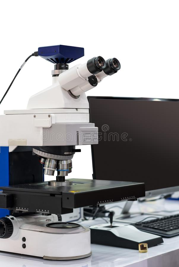 Modern & high accuracy microscope during sample or specimen inspection for quality control in industrial metallurgy electronic stock images