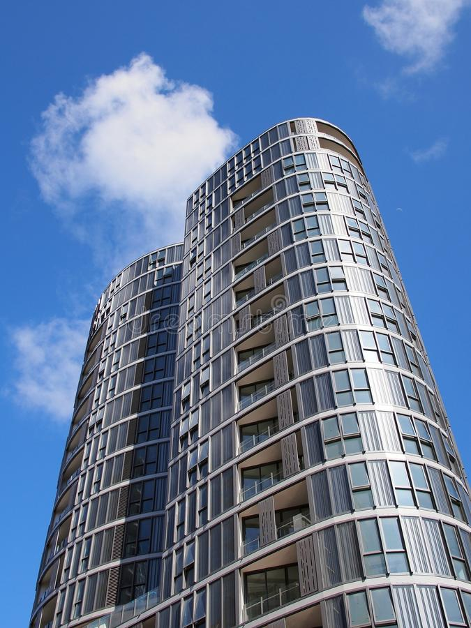 Modern High Rise Apartment Building. A new high rise apartment or condominium building, with rounded towers and enclosed balconies stock photos
