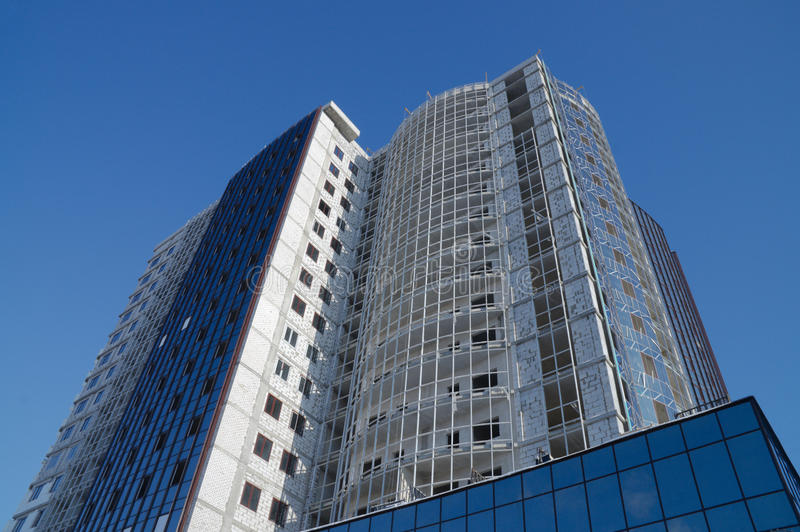 Modern high-rise building. Construction of a modern high-rise apartment building royalty free stock images