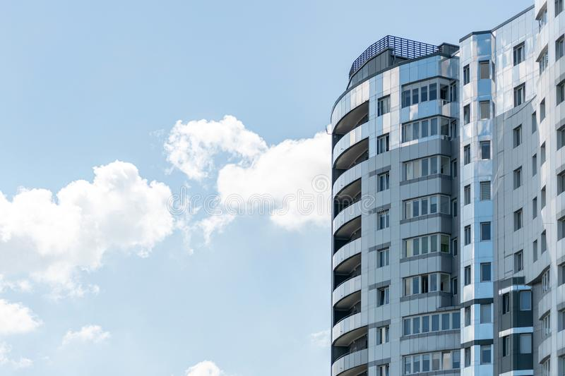 Modern high-rise building, copy space. Luxury multi storey skyscraper with flats and apartments for housing stock photo