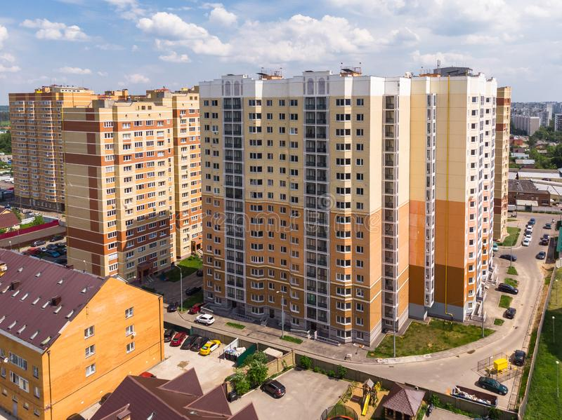 Modern high-rise residential buildings in the Moscow region, Russia. Moscow region landscape with high-rise and a private houses stock images