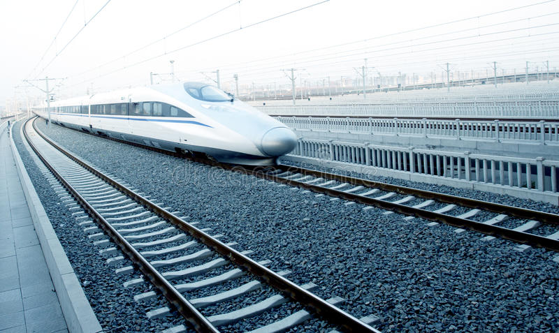 Modern high speed bullet train on track royalty free stock image