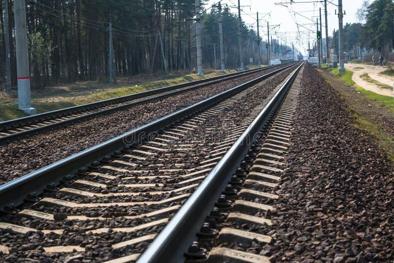 Modern high-speed railway.Railroad tracks.Railway track covered with gravel.Eastern Europe.  stock photo