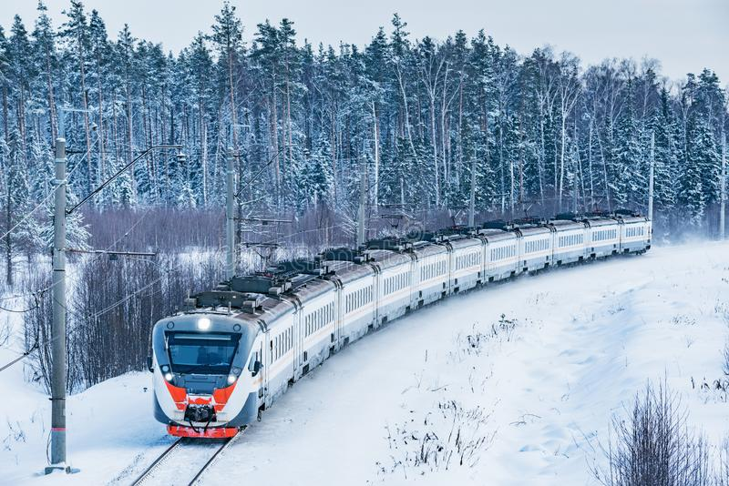 Modern high-speed train approaches to the station royalty free stock photo