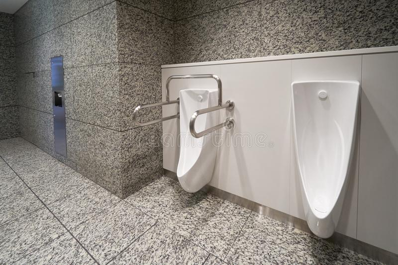 Modern high tech toilet with electronic bidet in Japan. Industry leaders recently agreed on signage standards for Japanese toilet. Bowls royalty free stock photos