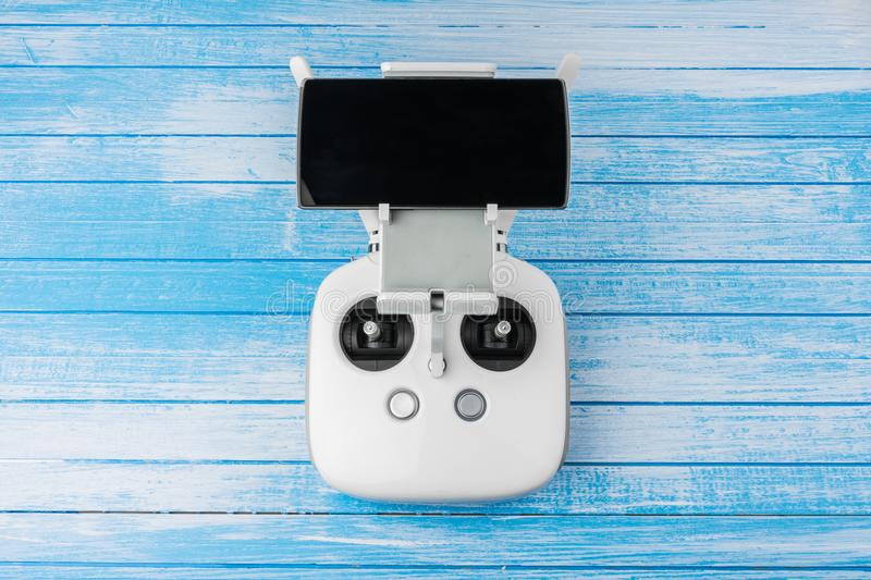 Modern High Tech White Drone Remote Controller With Smart Phone royalty free stock photos