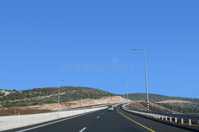 Modern highway through hilly terrain with curves stock image