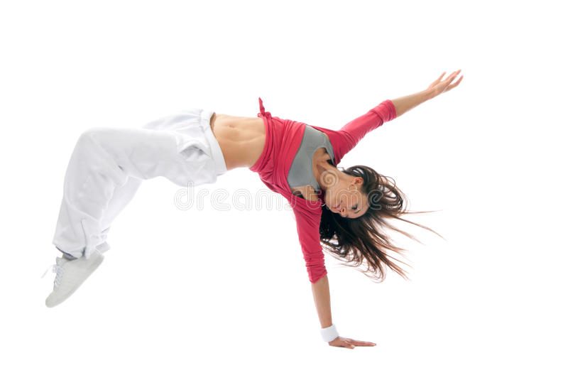Modern hip-hop style woman dancer break dancing. New pretty modern slim hip-hop style woman dancer break dancing isolated on a white studio background stock photos