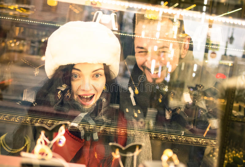 Modern hipster couple shopping on winter Christmas time stock photos