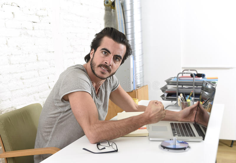 Modern hipster style student or businessman working in stress with laptop at home office angry upset. Young modern hipster style student or businessman working royalty free stock photos