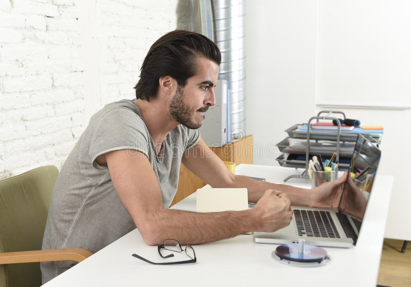 Modern hipster style student or businessman working in stress with laptop at home office angry upset royalty free stock images