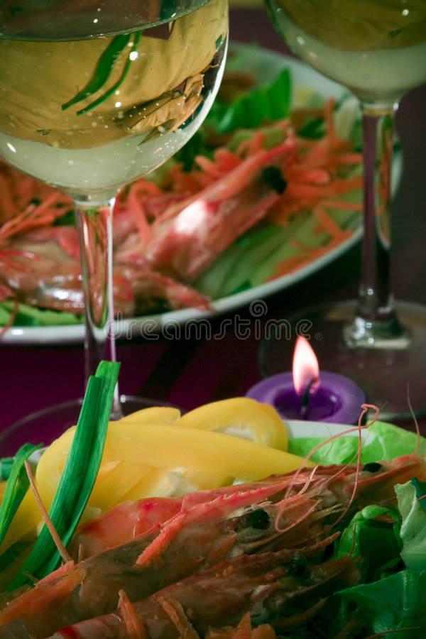 Modern holiday dinner. Close composition of a modern, asian-fusion dinner setup, with intimate, festive, dim lighting, a nowadays urban trend stock image