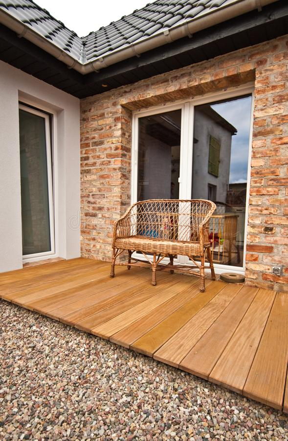 Modern backyard corner design with wooden deck and pebbles stock photography