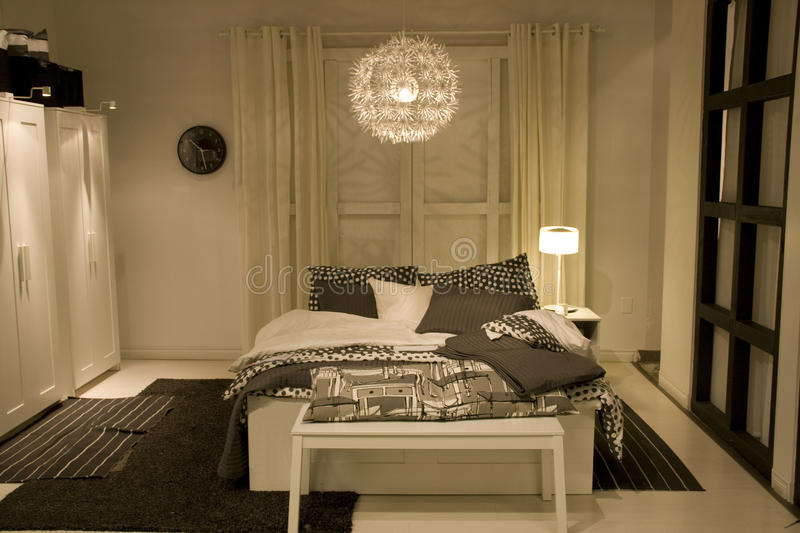 Modern home bedroom furniture. Nice bedroom with modern furniture and lighting stock images