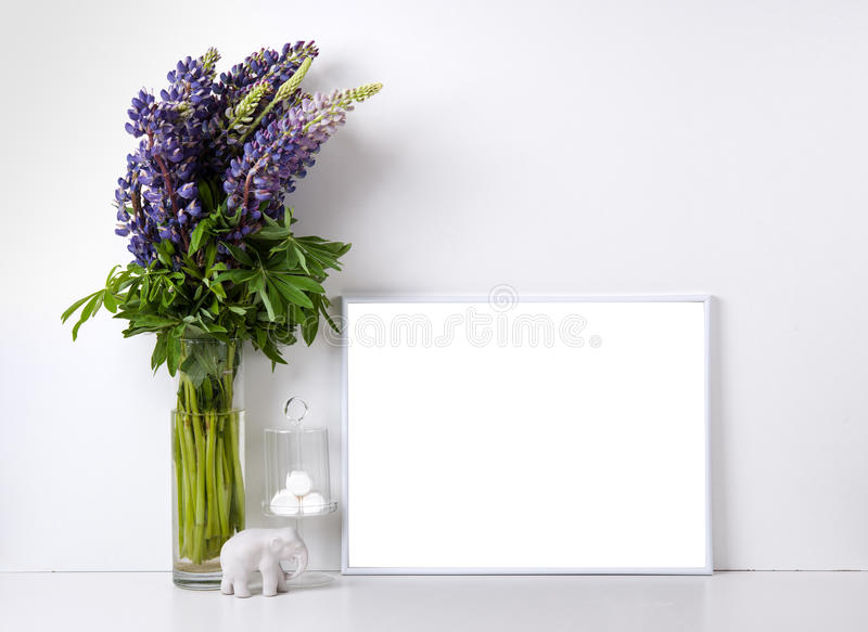 Modern home decor mock-up. Modern home decor with frame and interior objects, design ready poster mock-up stock photos