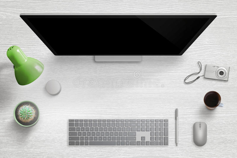 Modern home desk workplace. Computer display with keyboard, mouse, pen, dial, lamp, plant, cup of coffee and digital camera. Free space for hero header image royalty free stock photos