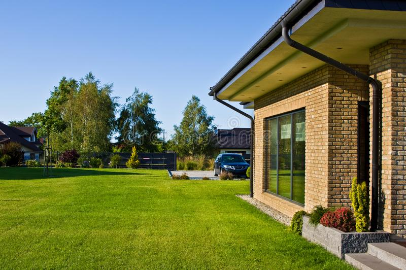 Modern house side yard with large garden window stock photos