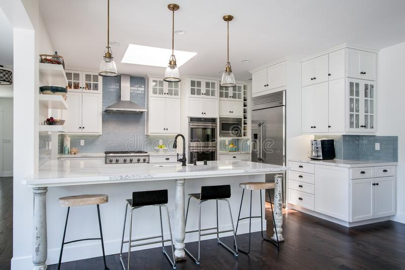Modern home interior design, kitchen, white cabinets, house royalty free stock image