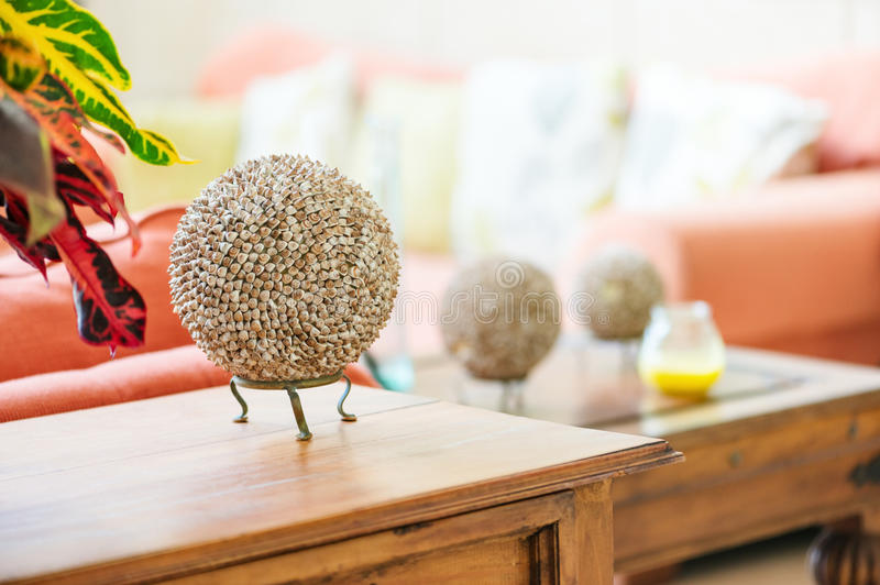 Modern home interior living room detail seashell balls on table top craft item object.  royalty free stock image