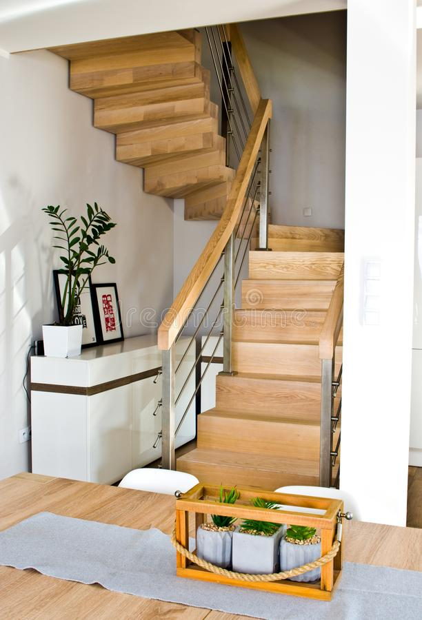 Modern home living room area with wooden stairs royalty free stock photos