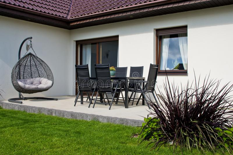 Modern private house terrace design in summer stock photos