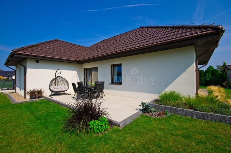 Modern private house terrace design in summer royalty free stock photography