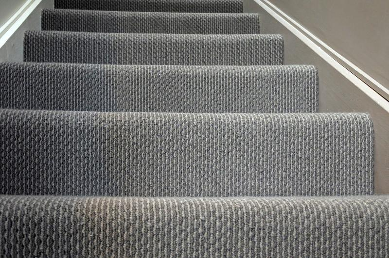 Modern home staircase carpet background stock photo