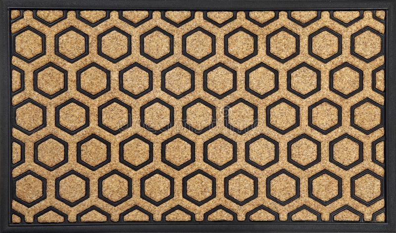 Modern Honeycomb design peach color doormat with black border stock photography