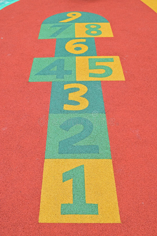 Modern Hopscotch Game. Colorful Modern Hopscotch Game at children playground with protective rubber surface royalty free stock photo
