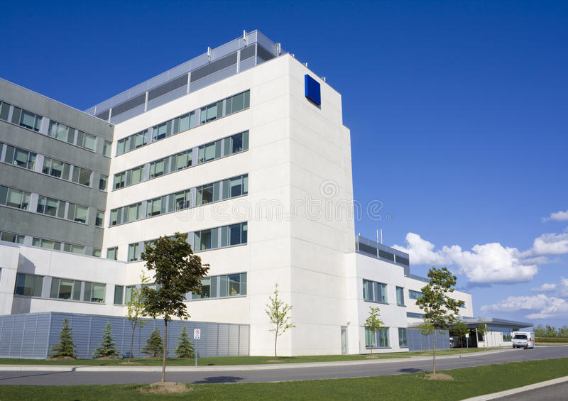 Modern hospital building. With ambulance stock photography
