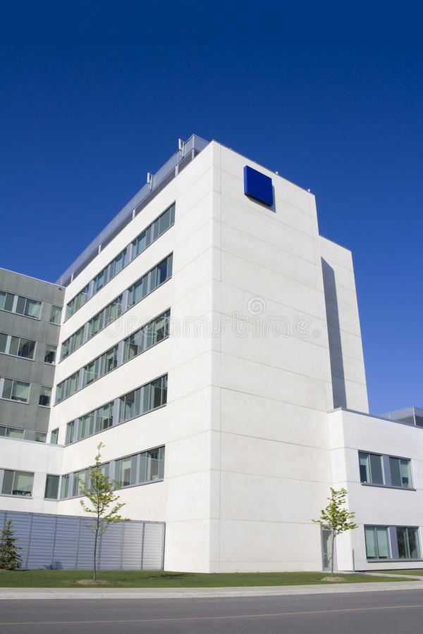 Modern hospital building. With ambulance royalty free stock photos